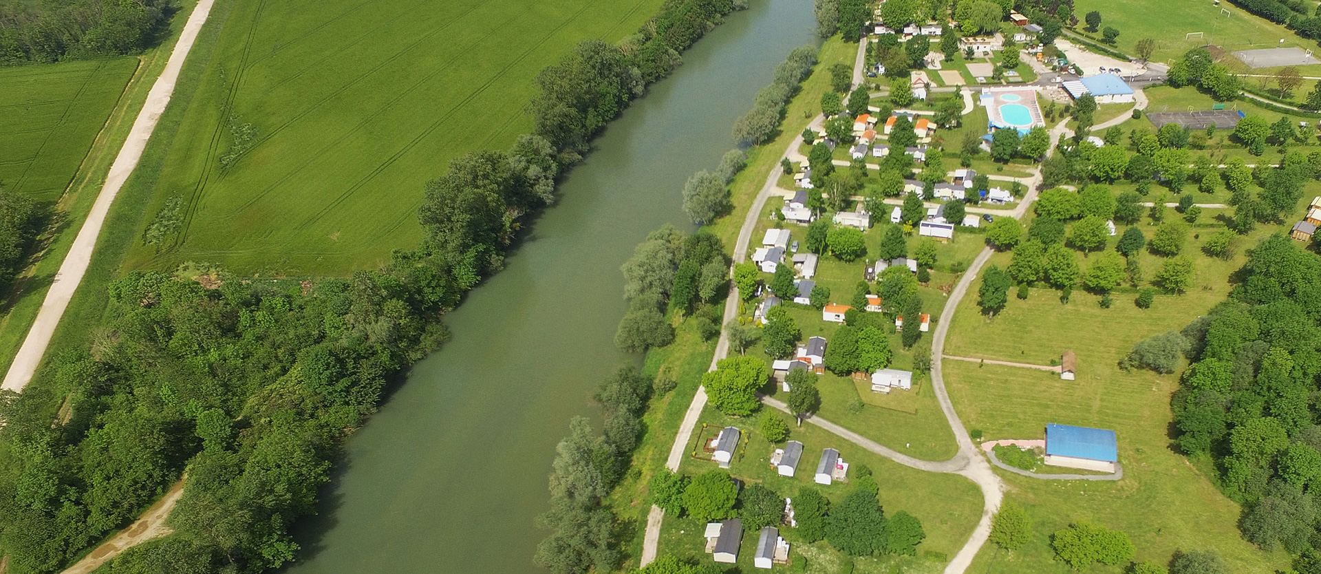 Aerial view of the campsite, chalet rental and mobile home in the Jura